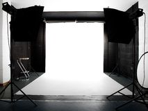 Empty studio with lights and white background Royalty Free Stock Images