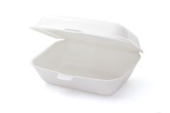 Empty styrofoam meal box. Open and empty styrofoam meal box isolated on white ground royalty free stock image