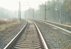 Empty suburban railroad leading to the horizon on a sunny day Royalty Free Stock Images