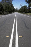 Empty Suburban Street With Line Marking. On A Sunny Summer Day, Sydney, Australia royalty free stock images