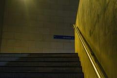 Subway stairs. Empty subway stairs under yellowish light Stock Image