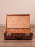 Empty suitcase in room. On laminate Stock Photo