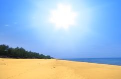 Empty summer beach. Wide empty summer beach with brightly shining sun Royalty Free Stock Photo