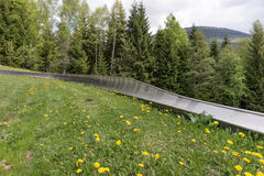 Empty summer toboggan run. In the mountains Royalty Free Stock Image