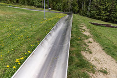 Empty summer toboggan run Stock Photo