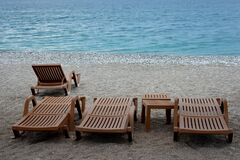 Empty sun beds by the Mediterranean sea.