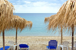 Empty sun beds with umbrellas on the beach Royalty Free Stock Photography