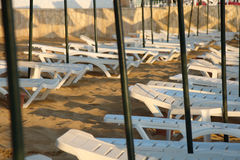 Empty sun loungers. A lots of empty sun loungers royalty free stock photography