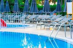 Empty sun loungers around the pool Royalty Free Stock Photography