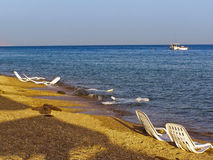 Empty sun loungers after a beach day. Evening at one of the beaches of Sharm El-Sheikh, Egypt Stock Photos