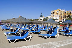 Empty sun loungers on Cabopino beach Royalty Free Stock Photo