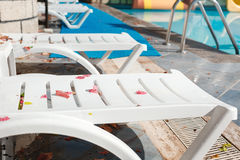 Empty sun loungers at the hotel with fallen leaves Stock Images