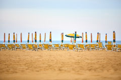 Empty sun lounges and closed parasols on the beach Royalty Free Stock Photography