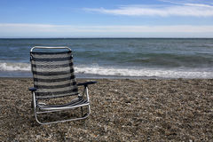 Empty sunbed on the beach. Empty striped sunbed on the beach Royalty Free Stock Photo