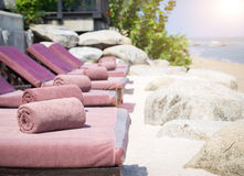 Empty sunbed with wrapped towels on a beautiful beach. On sunny day Royalty Free Stock Image