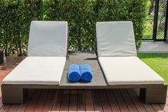 Empty sunbed with wrapped towels Stock Images