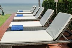 Empty sunbed with wrapped towels Royalty Free Stock Photos