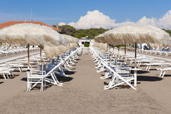 Empty sunbeds on the beach Royalty Free Stock Photo