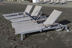 Empty sunbeds on the beach out of season. Stock Image