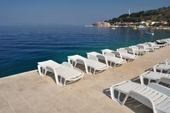 Empty sunbeds in beach of Podgora Royalty Free Stock Image