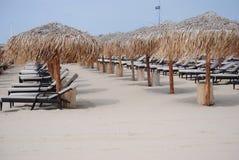 Empty Sunbeds. In beautiful sunny weather on beach in svetti vlas Bulgaria lazy holidays tropical parasol umbrella suntan white sand Royalty Free Stock Photos