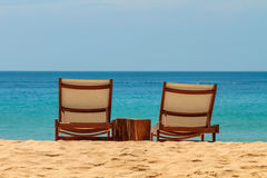 Empty sunbeds on a gorgeous sandy beach Stock Images