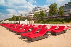 Empty sunbeds in a row on the sand beach Stock Photo