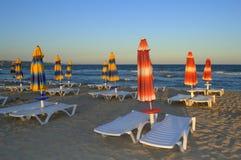 Empty sunbeds on sunset beach stock image