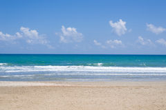 Empty, sunny beach with blue sky Royalty Free Stock Image
