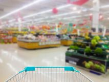 Empty supermarket aisle. With shopping cart stock image