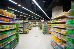 Empty supermarket aisle Stock Image