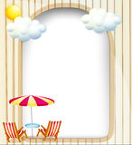 An empty surface with beach chairs and umbrella Royalty Free Stock Photo