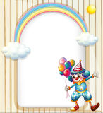 An empty surface with a clown holding balloons Stock Image