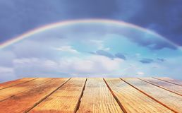 Empty surface of a wooden table on a rainbow background stock photos