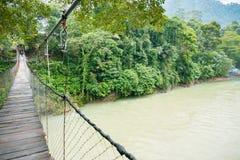 Suspension Bridge River in Tangkahan, Indonesia. An empty suspension bridge across Tangkahan River in Tangkahan, Indonesia royalty free stock images