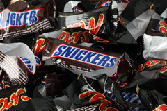 Empty sweet wrappers of Snickers and Mars candy bars Royalty Free Stock Photography