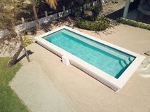 Empty swimming pool with blue water royalty free stock photography