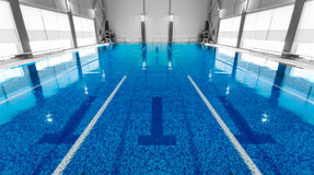 Empty swimming pool with clean blue water Royalty Free Stock Image