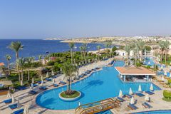 Empty swimming pool early in the morning at the hotel near red sea, Egypt royalty free stock image
