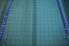 Empty swimming pool with lane markers Royalty Free Stock Photography