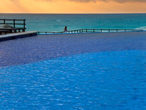 Empty swimming pool and sea Royalty Free Stock Photos