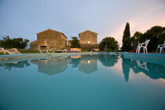 Empty swimming pool at sunset france. An empty swimming pool at sunset france Royalty Free Stock Images