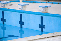 Empty swimming pool with swimming starting blocks Royalty Free Stock Photo