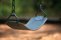 Empty Swing. On a Playground royalty free stock photo