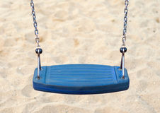 Empty swing. Empty blue swing on children playground Royalty Free Stock Photo