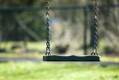 Empty swing. As a symbol of dead from a child Stock Photos