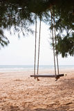 An empty swing at the beach Stock Image