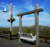 Empty swing on the beach, Carolina Beach, North Carolina stock photo