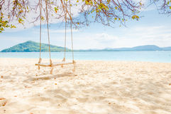 Empty swing on the beach at Rang yai island, Thailand Royalty Free Stock Photo