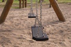 Empty swing on children playground Stock Photo